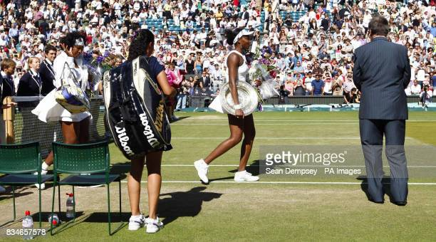 USA's Venus Williams and Serena Williams leave the court during the Wimbledon Championships 2008 at the All England Tennis Club in Wimbledon