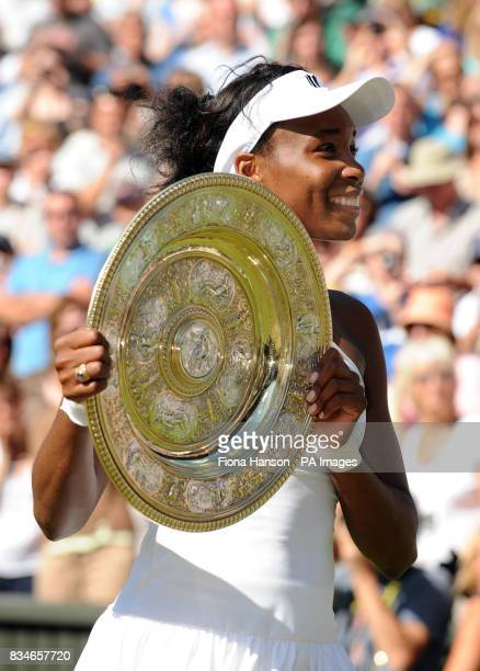 USA's Venus Williams celebrates her victory over USA's Serena Williams following their Ladies' Final during the Wimbledon Championships 2008 at the...