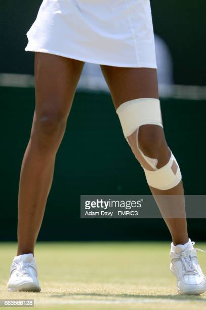 USA's Venus Williams has her knee strapped up during the match against Serbia's Ana Ivanovic