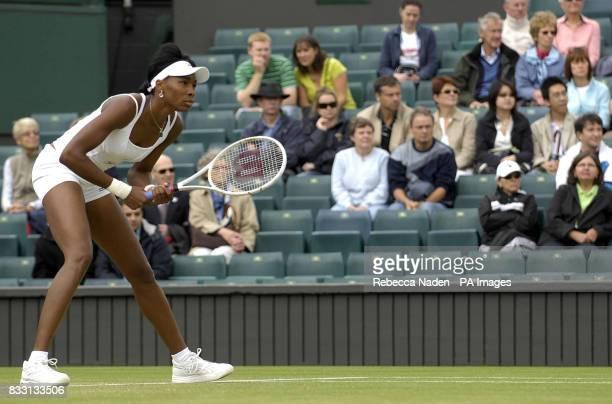 USA's Venus Williams in action against Russia's Svetlana Kuznetsova during The All England Lawn Tennis Championship at Wimbledon