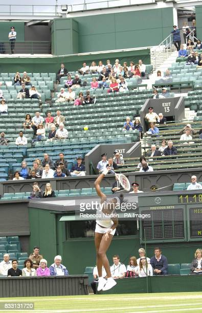 USA's Venus Williams in action against Russia's Svetlana Kuznetsova on Centre Court during The All England Lawn Tennis Championship at Wimbledon
