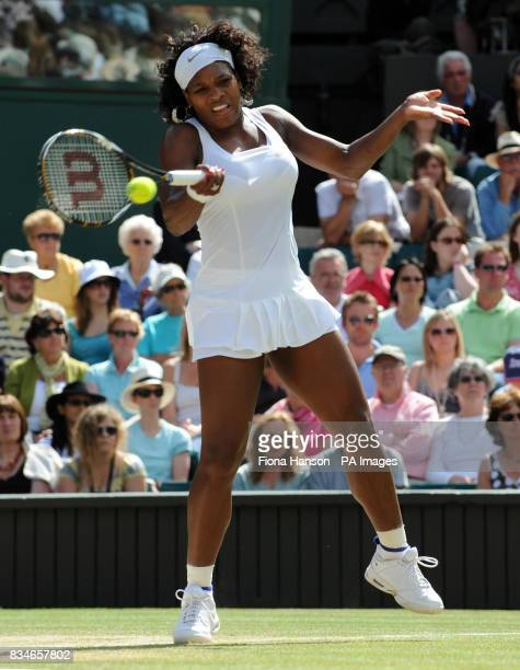 USA's Venus Williams in action against USA's Serena Williams during their Ladies' Final during the Wimbledon Championships 2008 at the All England...