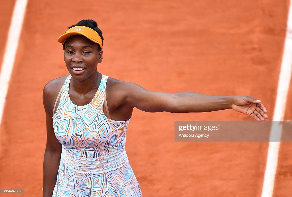 US's Venus Williams reacts during the match against her compatriot Louisa Chirico (not seen) in their women's single second round match at the French Open tennis tournament at Roland Garros in Paris, France on May 26, 2016.