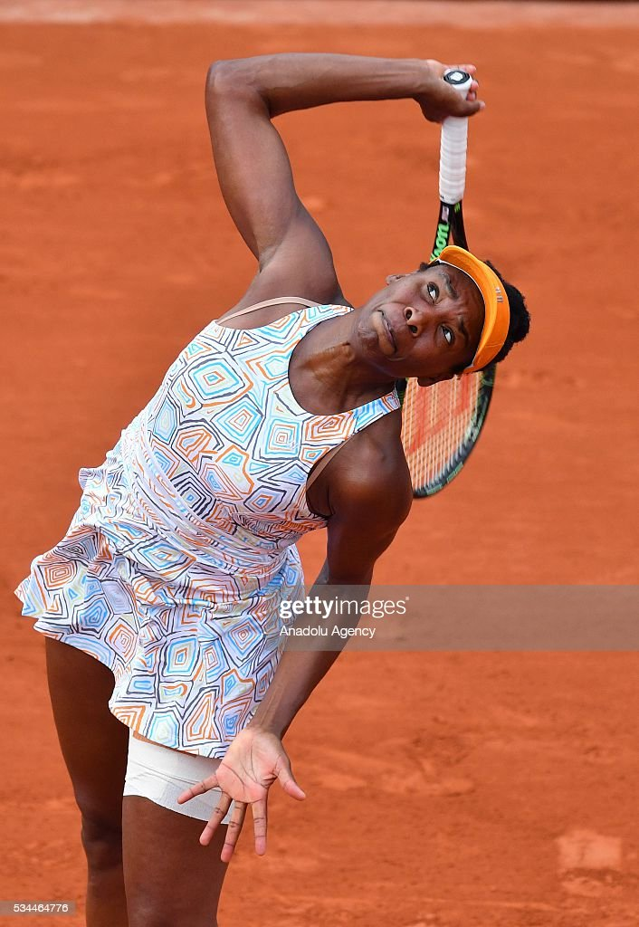 US's Venus Williams serves to her compatriot Louisa Chirico (not seen) during their women's single second round match at the French Open tennis tournament at Roland Garros in Paris, France on May 26, 2016.