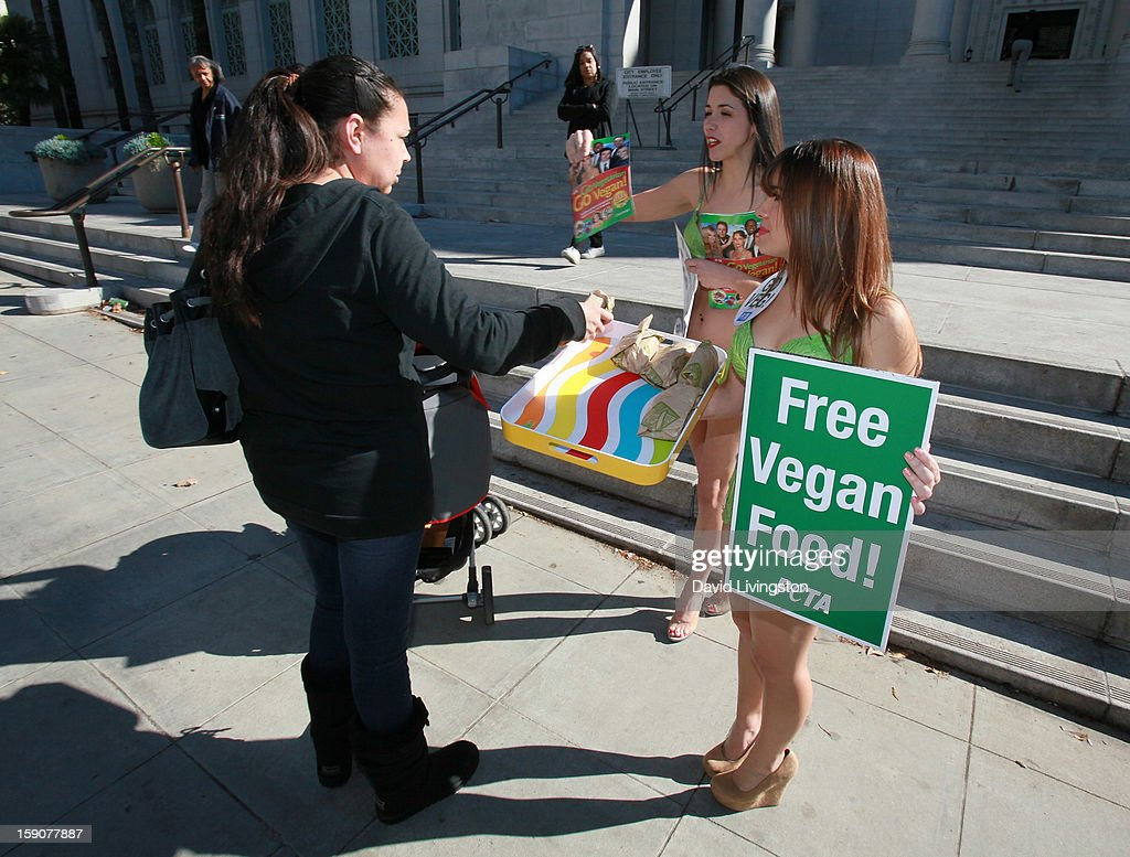 PETA's Virginia Fort and Ashley Perez (R) attend PETA's Sexy Lettuce Ladies unveiling of the new PETA 'Turn Over A New Leaf: Go Vegan' campaign at Los Angeles City Hall on January 7, 2013 in Los Angeles, California.