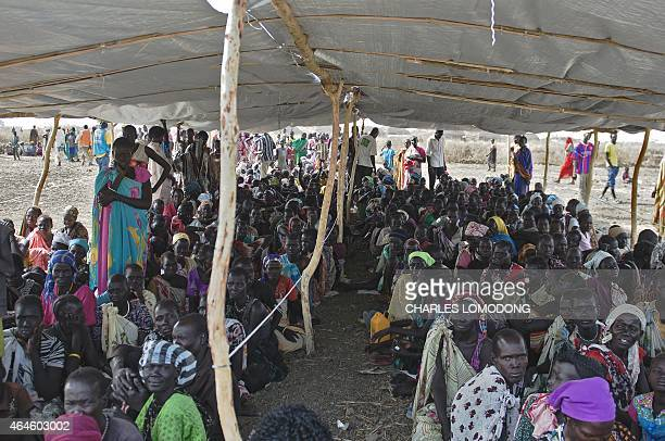 IDP's wait to receive food rations at the UNMISS Protection of Civilian site in Bentiu Unity State on February 27 2015 The camp receives up to 200...