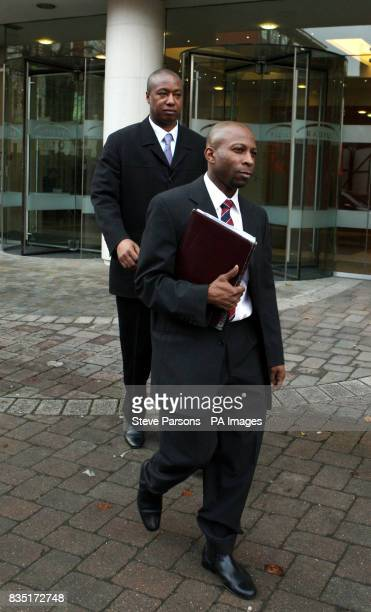 PCSO's Wayne Bell and Clint Charles leave an employment tribunal in Watford Hertfordshire after giving evidence against the Metropolitan Police for...