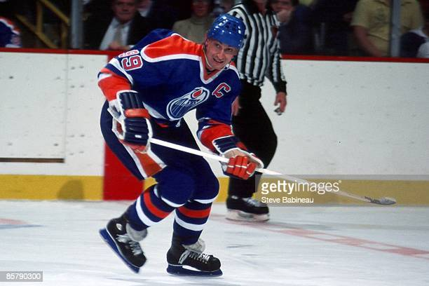 BOSTON MA 1980's Wayne Gretzky of the Edmonton Oilers skates hard in the neutral zone against the Boston Bruins at the Boston Garden