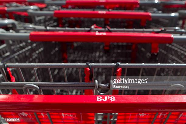 BJ's Wholesale Club Inc shopping carts sit outside a store in Falls Church Virginia US on Tuesday March 27 2012 The US Bureau of Economic Analysis is...