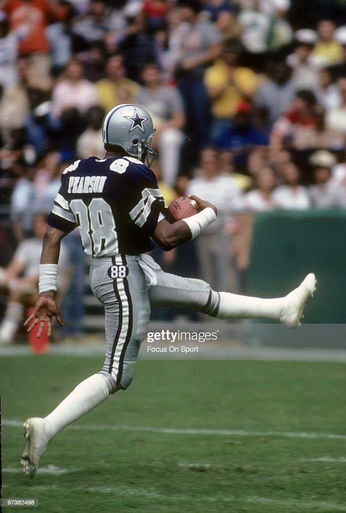 Wide Receiver <a gi-track='captionPersonalityLinkClicked' href=/galleries/search?phrase=Drew+Pearson&family=editorial&specificpeople=226652 ng-click='$event.stopPropagation()'>Drew Pearson</a> #88 of the Dallas Cowboys in action carries the ball into the endzone for a touchdown against the Washington Redskins circa 1980's during an NFL football game at RFK Stadium in Washington, D.C.. Pearson played for the Cowboys from 1973-83.