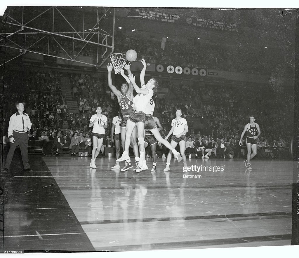 Willie Naulls Trying to Catch a Rebound Ball