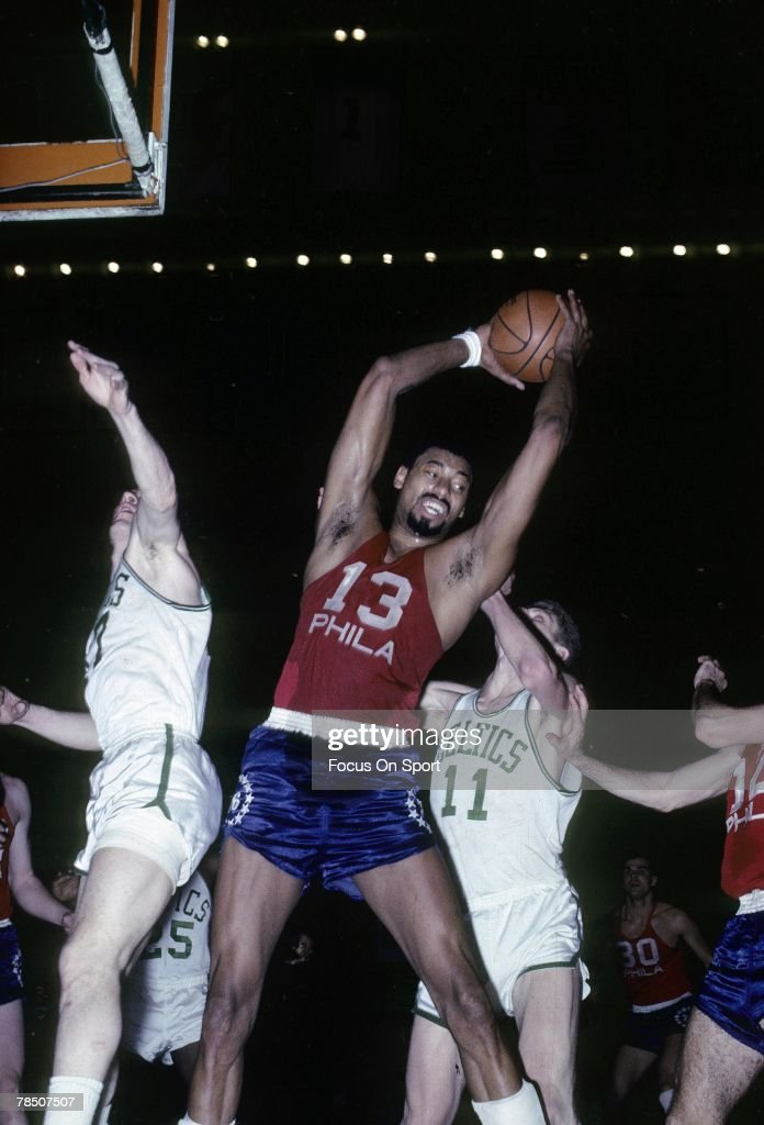 BOSTON MA CIRCA 1960's Wilt Chamberlain of the Philadelphia 76ers pulls down a rebound against the Boston Celtics during an mid circa 1960's NBA...