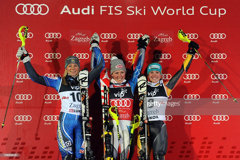 USA's winner Mikaela Shiffrin (C), Sweden's second placed Frida Handsdotter (L) and Canada's third placed Erin Mielzynski pose on the podium of the FIS World Cup women's slalom in Sljeme, near Zagreb, on January 4, 2013.