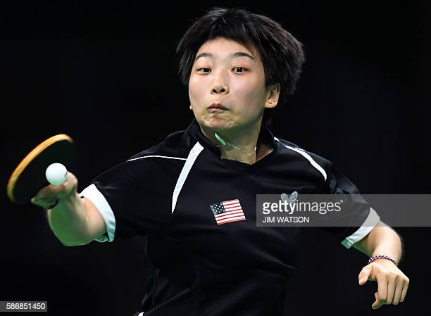 USA's Yue Wu hits a shot in her women's singles qualification round table tennis match at the Riocentro venue during the Rio 2016 Olympic Games in...