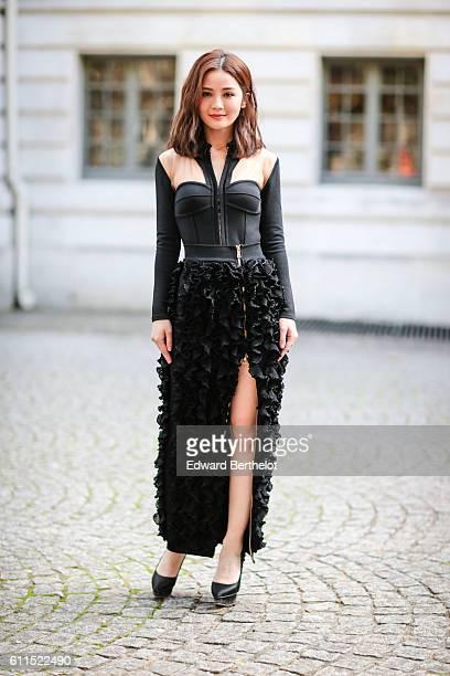 Sa is wearing a black dress outside the Balmain show at Hotel Potocki during Paris Fashion Week Spring Summer 2017 on September 29 2016 in Paris...