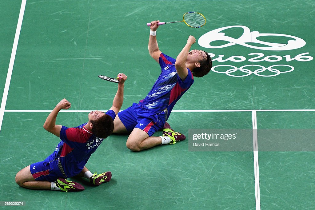 Sa Rang Kim and Jung Kim Gi of Republic of Korea celebrate defeating Carsten Mogensen and Mathias Boe of Denmark during the Men's Doubless Play Stage...