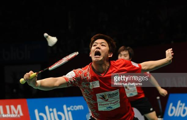 Sa Rang Kim and Lee Yong Dae of Musica Champions Indonesia compete against Sung Hyun Ko and Baek Cheol Shin of PB Djarum Indonesia during the Mens...