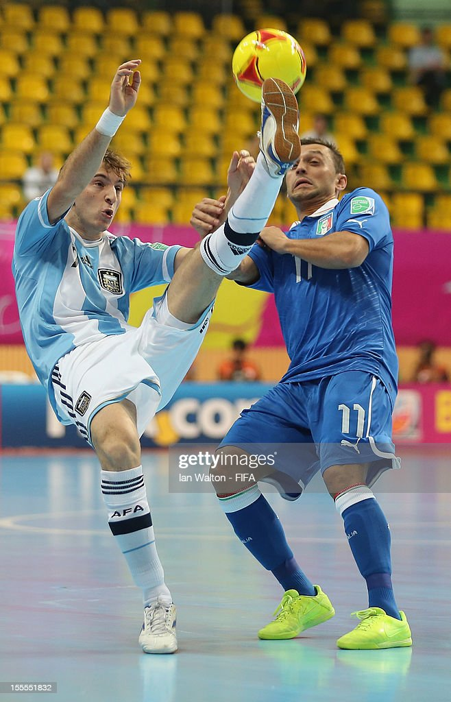 Saad Assis of Italy tries to tackle Leandro Cuzzolino of Argentina during the FIFA Futsal World Cup Thailand 2012, Group D match between Argentina and Italy at Nimibutr Stadium on November 5, 2012 in Bangkok, Thailand.