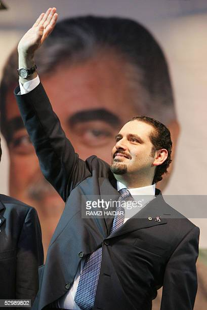 Saad Hariri son of slain former premier Rafiq Hariri waves to supporters during an election rally in Beirut 27 May 2005 The shadow of Hariri credited...