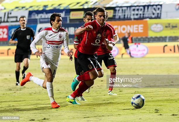 Saad Samir of Al Ahly in action against Aymen Hanefy of Zamalek during the Egypt Premier League match between Al Ahly and Zamalek at the Petro Sport...