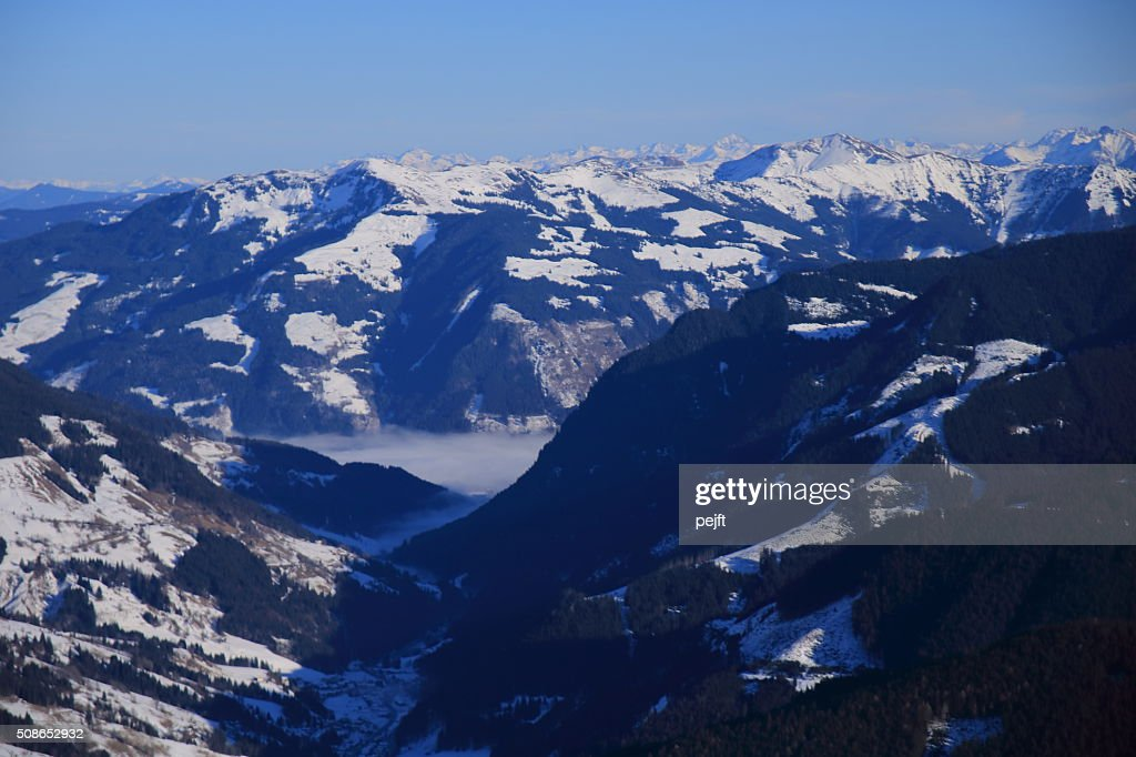 Saalbach, Austria at winter time above the clouds : Stock Photo
