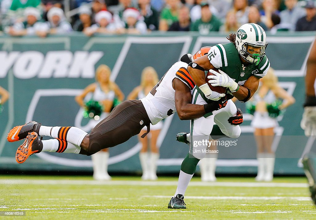 Saalim Hakim of the New York Jets in action against Barkevious Mingo of the Cleveland Browns on December 22 2013 at MetLife Stadium in East...