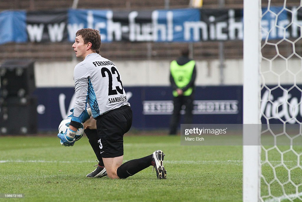 Saarbruecken's goalkeeper Benedikt Fernandez holds the ball in his hands during the Third League match between 1. FC Saarbruecken and Hallescher FC at Ludwigsparkstadion on November 24, 2012 in Saarbruecken, Germany.