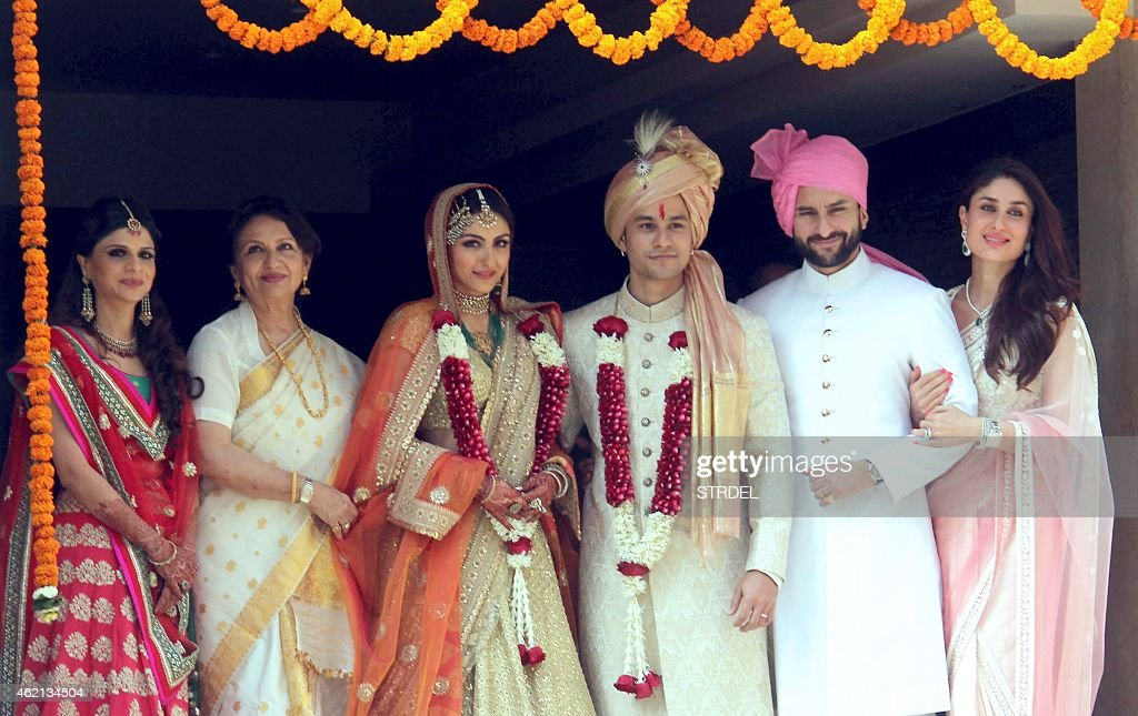Saba Ali Khan (L), Sharmila Tagore (2nd L), Saif Ali Khan (2nd R), and Kareena Kapoor Khan (R) pose during the wedding of Soha Ali Khan (3rd L) and Kunal Khemu (3rd R) in Mumbai on January 25, 2015.