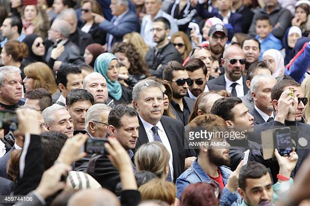 Sabah Shammas the son of Sabah attends the funeral of iconic Lebanese singer and actress on November 30 at the St Georges Maronite Cathedral in the...