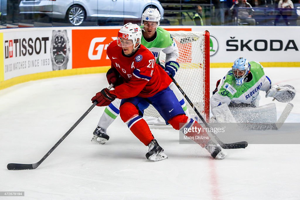 Sabahudin Kovacevic (R) of Slovenia and <a gi-track='captionPersonalityLinkClicked' href=/galleries/search?phrase=Anders+Bastiansen&family=editorial&specificpeople=2487581 ng-click='$event.stopPropagation()'>Anders Bastiansen</a> (L) of Norway battle for the puck during the IIHF World Championship group B match between Slovenia and Norway at CEZ Arena on May 8, 2015 in Ostrava, Czech Republic.
