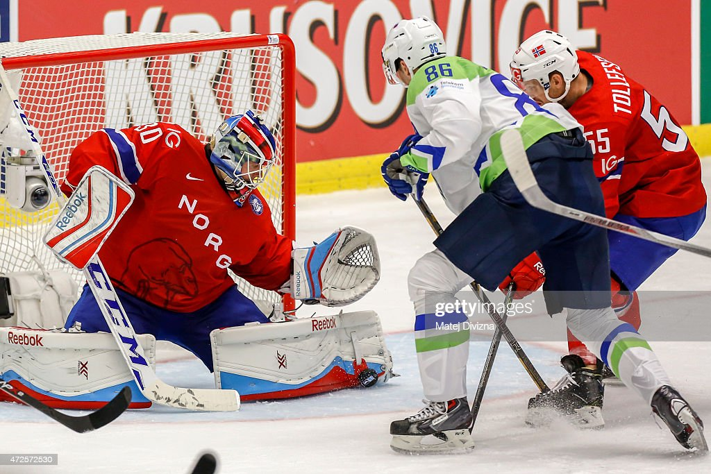 Sabahudin Kovacevic (C) of Slovenia tries to score against <a gi-track='captionPersonalityLinkClicked' href=/galleries/search?phrase=Lars+Haugen&family=editorial&specificpeople=7718894 ng-click='$event.stopPropagation()'>Lars Haugen</a> (L), goalkeeper of Norway, during the IIHF World Championship group B match between Slovenia and Norway at CEZ Arena on May 8, 2015 in Ostrava, Czech Republic.