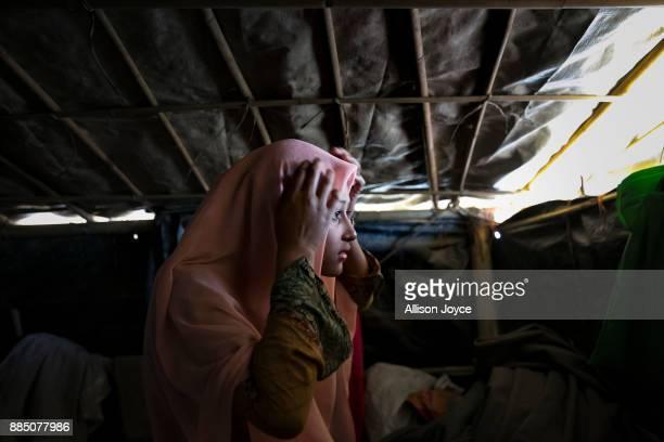 COX'S BAZAR BANGLADESH NOVEMBER 29 Sabakur Nahar is seen in her tent November 29 2017 in Cox's Bazar Bangladesh She married Rahul Amin two months ago...