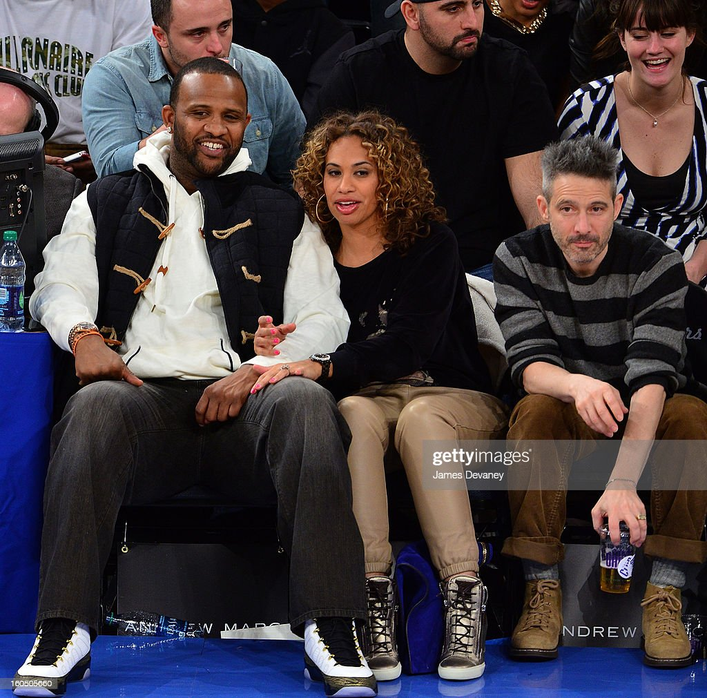 CC Sabathia, Amber Sabathia and Adam Horovitz attend the Milwaukee Bucks vs New York Knicks game at Madison Square Garden on February 1, 2013 in New York City.