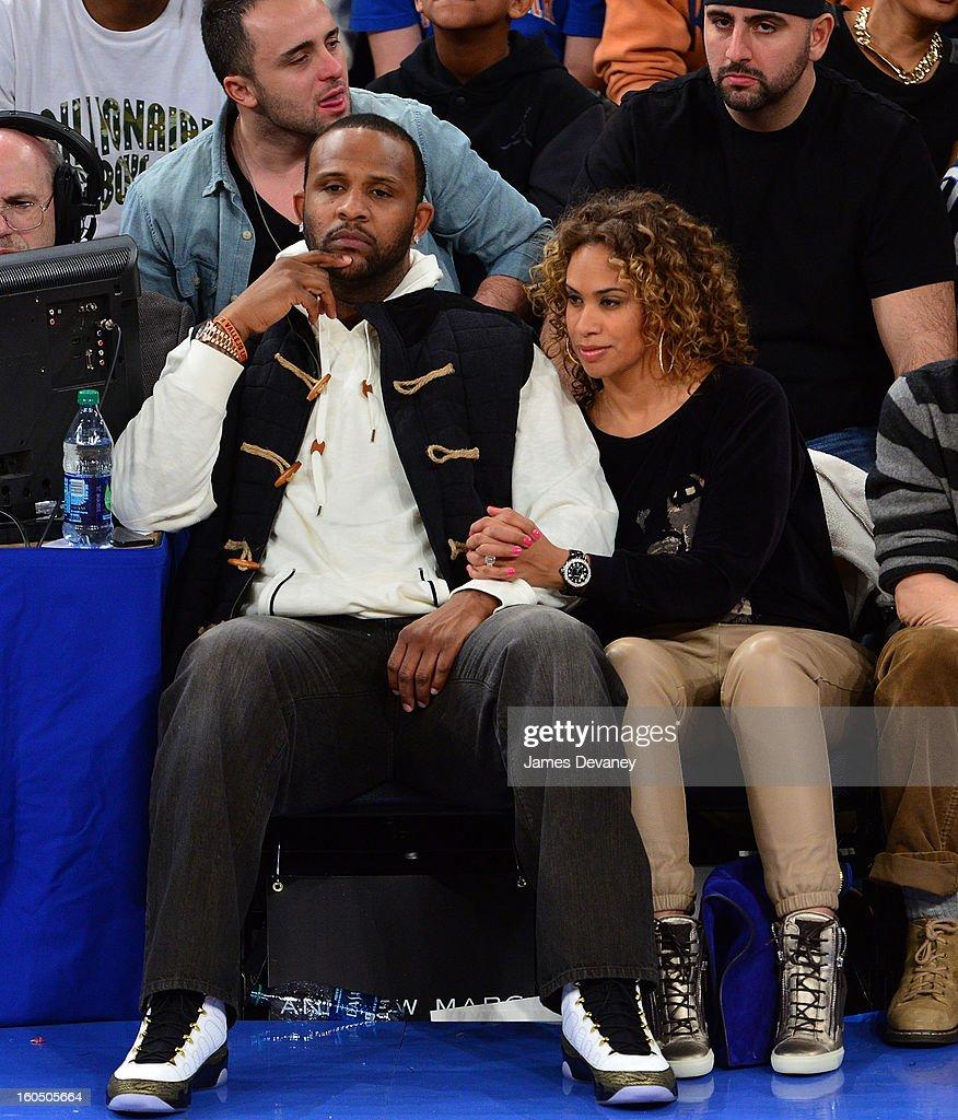 CC Sabathia and Amber Sabathia attend the Milwaukee Bucks vs New York Knicks game at Madison Square Garden on February 1, 2013 in New York City.