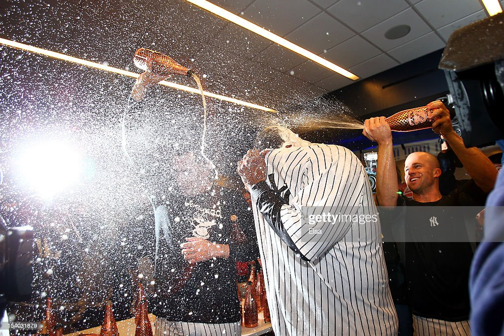 CC Sabathia #52 and Brett Gardner of the New York Yankees celerbrate in the locker room after defeating the Baltimore Orioles by a score of 3-1 to win Game Five of the American League Division Series at Yankee Stadium on October 12, 2012 in New York, New York.
