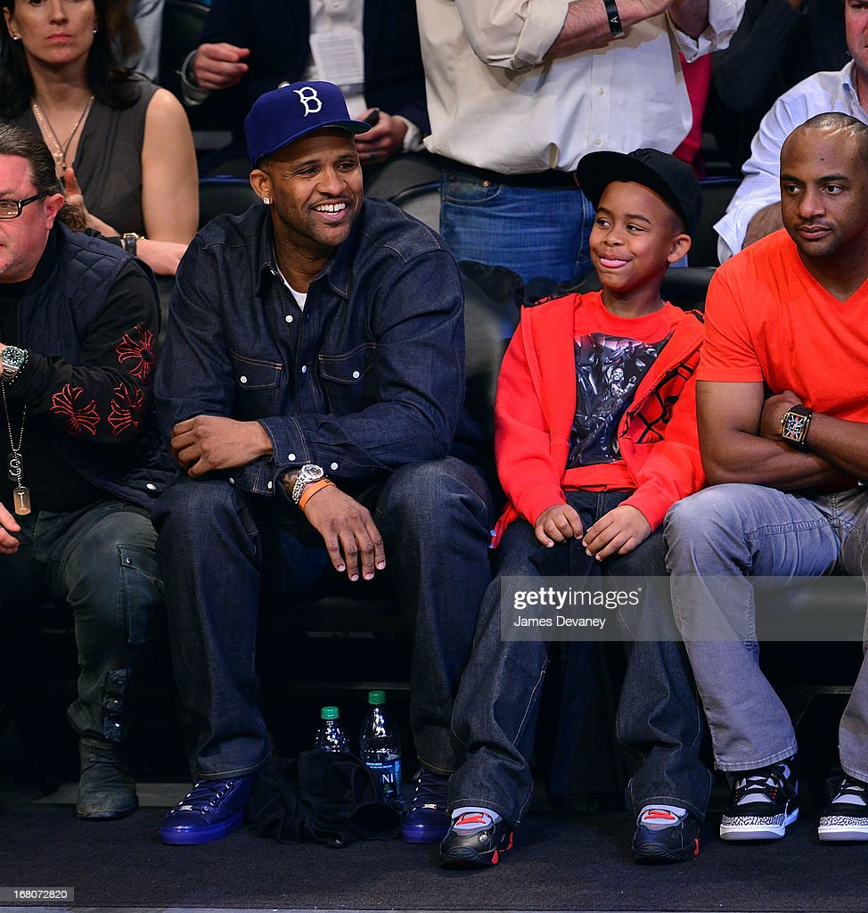 CC Sabathia and Carsten Charles III Sabathia attend the Chicago Bulls Vs Brooklyn Nets Playoff Game at the Barclays Center on May 4, 2013 in the Brooklyn borough of New York City.