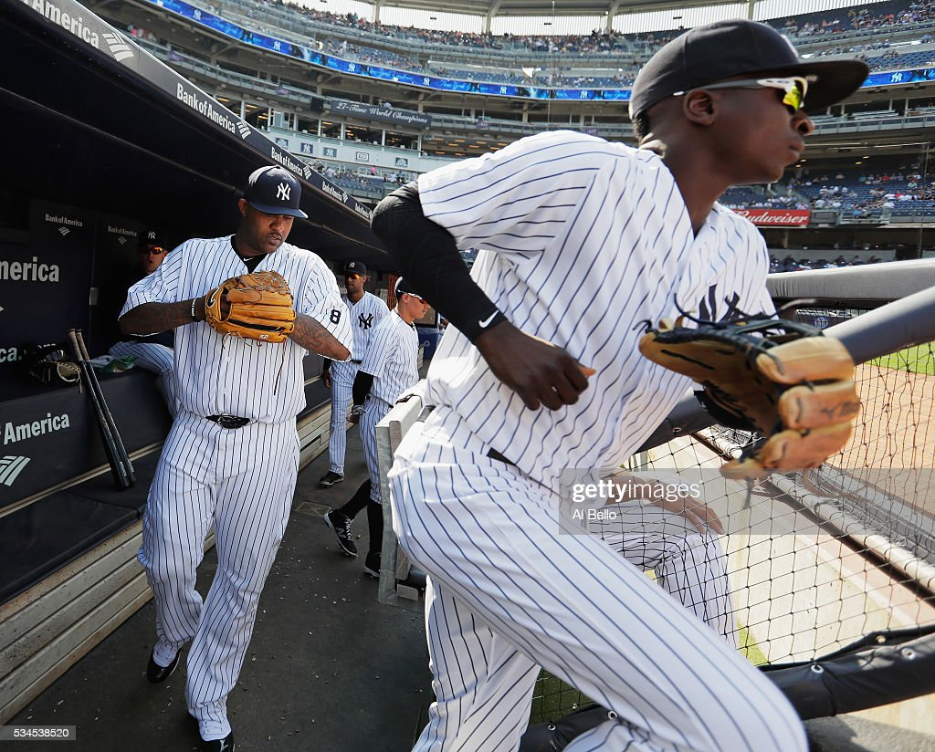 CC Sabathia #52 and <a gi-track='captionPersonalityLinkClicked' href=/galleries/search?phrase=Didi+Gregorius&family=editorial&specificpeople=8945889 ng-click='$event.stopPropagation()'>Didi Gregorius</a> #18 of the New York Yankees enter the game against the Toronto Blue Jays during their game at Yankee Stadium on May 26, 2016 in New York City.