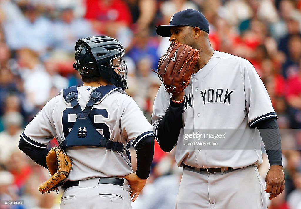 CC Sabathia #52 and J.R. Murphy #66 of the New York Yankees talk on the pitchers mound against the Boston Red Sox in the 6th inning during the game on September 14, 2013 at Fenway Park in Boston, Massachusetts.