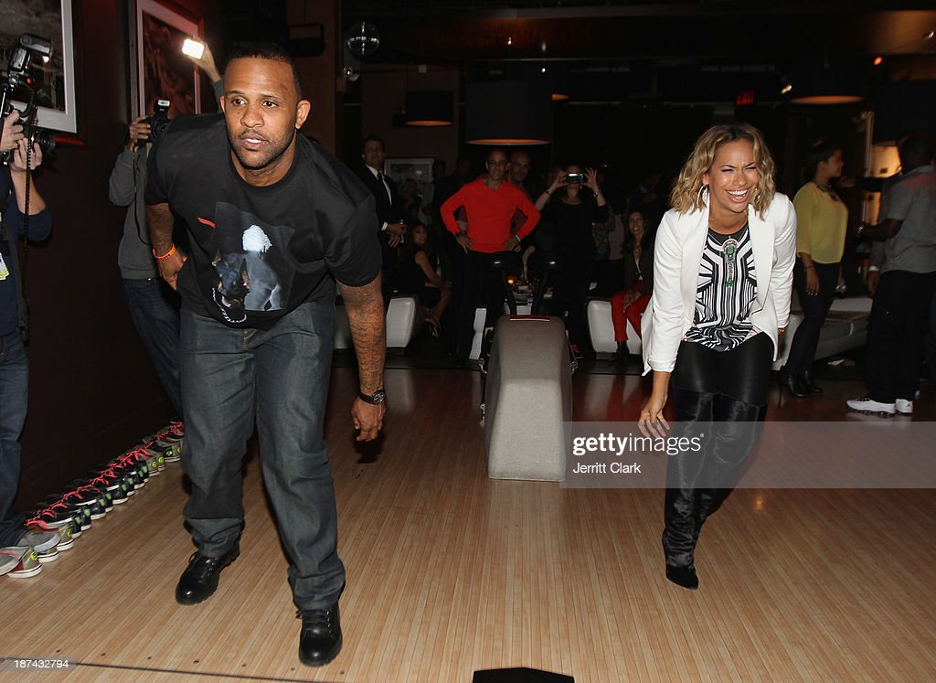 C.C. Sabathia and wife Amber Sabathia attend their PitCCh In Foundation 2013 Challenge Rules Party at Luxe at Lucky Strike Lanes on November 8, 2013 in New York City.