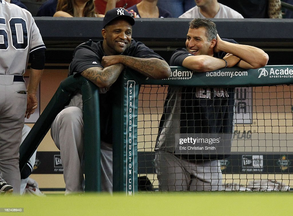 CC Sabathia #52, left, and Andy Pettitte #46 of the New York Yankees talk in the dugout during the seventh inning against the Houston Astros on September 29, 2013 at Minute Maid Park in Houston, TX.