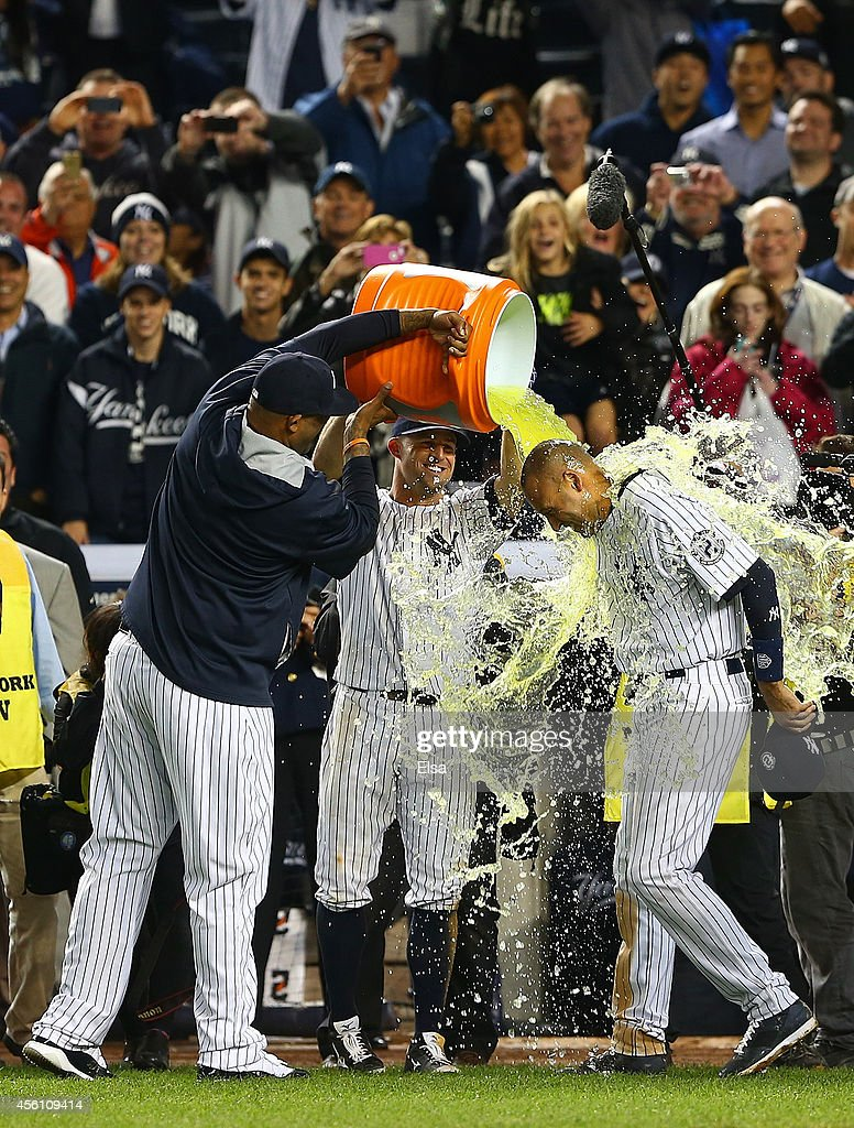 CC Sabathia #52 of the New York Yankees and Brett Gardner #11 dump Gatorade on Derek Jeter #2 after he hit a game winning RBI hit in the ninth inning against the Baltimore Orioles in his last game ever at Yankee Stadium on September 25, 2014 in the Bronx borough of New York City.