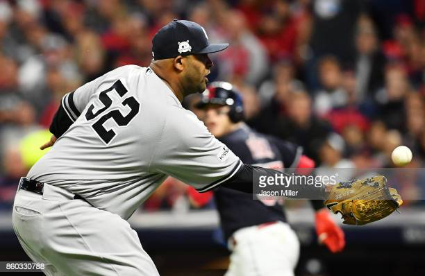 Sabathia of the New York Yankees catches a bunt by Roberto Perez of the Cleveland Indians in the third inning of game five of the American League...