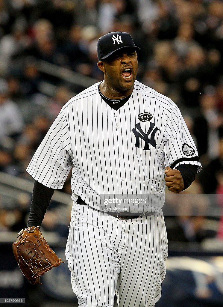 CC Sabathia #52 of the New York Yankees celebrates after he forced Josh Hamilton #32 of the Texas Rangers to ground into a double play to end the top of the fifth inning of Game Five of the ALCS during the 2010 MLB Playoffs at Yankee Stadium on October 20, 2010 in the Bronx borough of New York City.