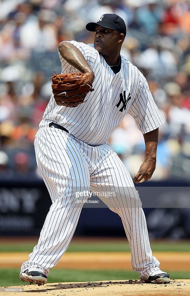 CC Sabathia #52 of the New York Yankees delivers a pitch against the New York Mets on June 20, 2010 at Yankee Stadium in the Bronx borough of New York City.