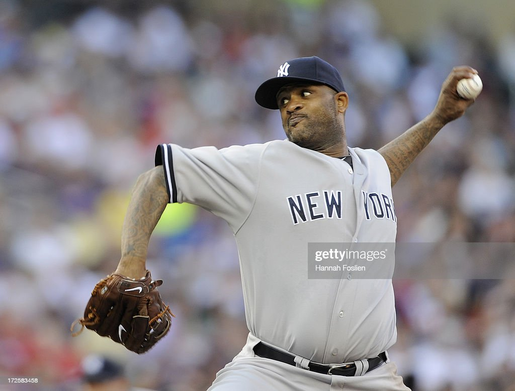 CC Sabathia #52 of the New York Yankees delivers a pitch against the Minnesota Twins during the third inning of the game on July 3, 2013 at Target Field in Minneapolis, Minnesota. The Yankees defeated the Twins 3-2.