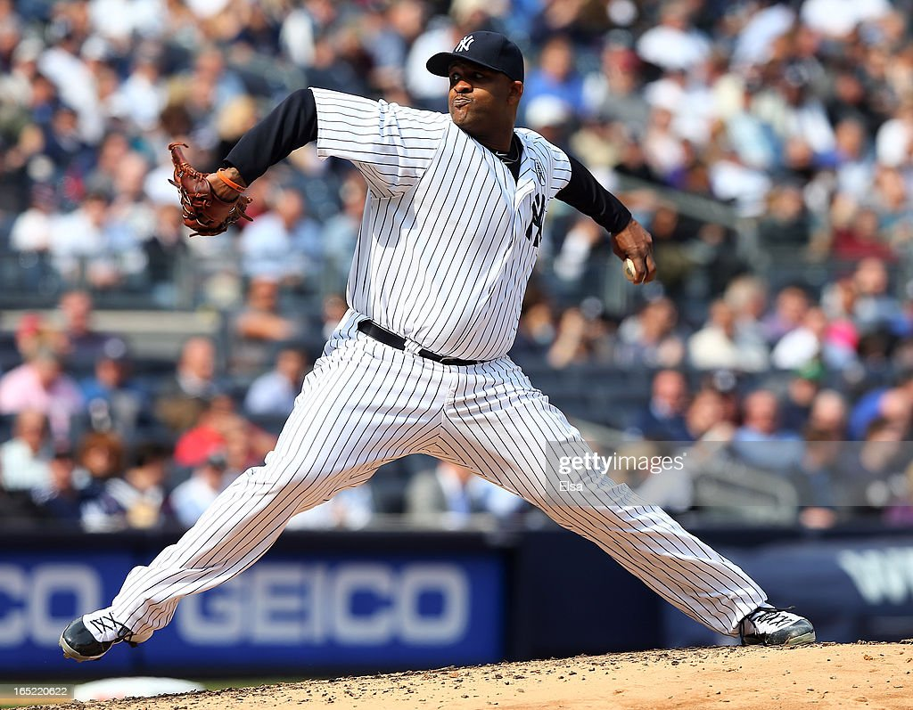 CC Sabathia #52 of the New York Yankees delivers a pitch in the second inning against the Boston Red Sox during Opening Day on April 1, 2013 at Yankee Stadium in the Bronx borough of New York City.