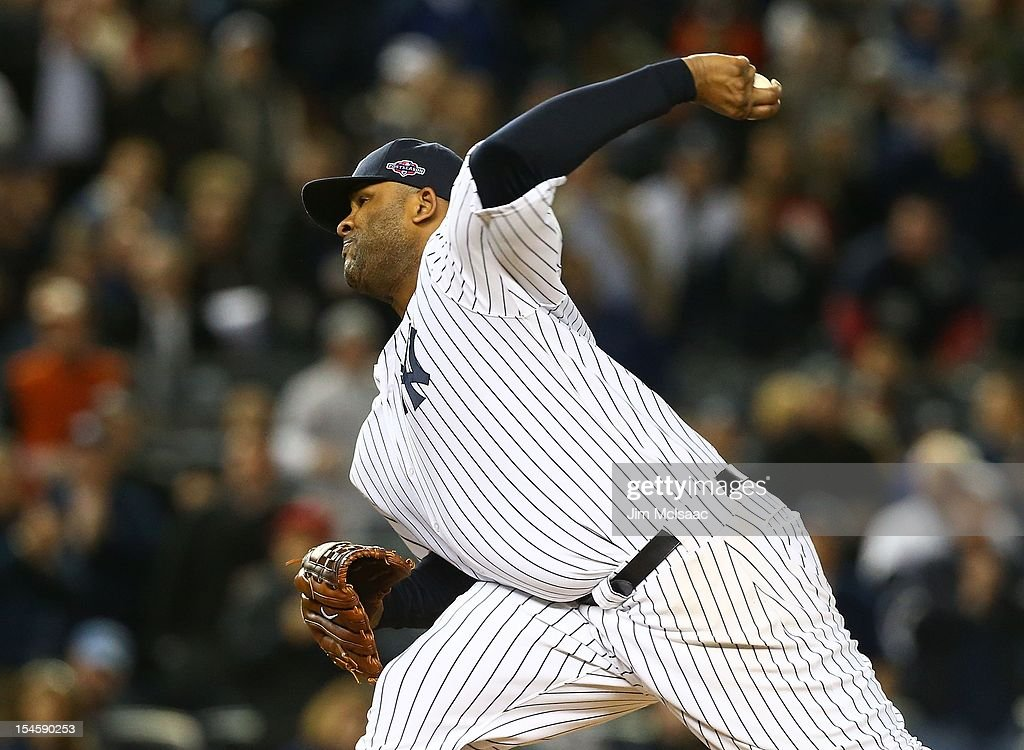 CC Sabathia #52 of the New York Yankees in action against the Baltimore Orioles during Game Five of the American League Division Series at Yankee Stadium on October 12, 2012 in the Bronx borough of New York City. The Yankees defeated the Orioles 3-1 to win their best of five series three games to two.