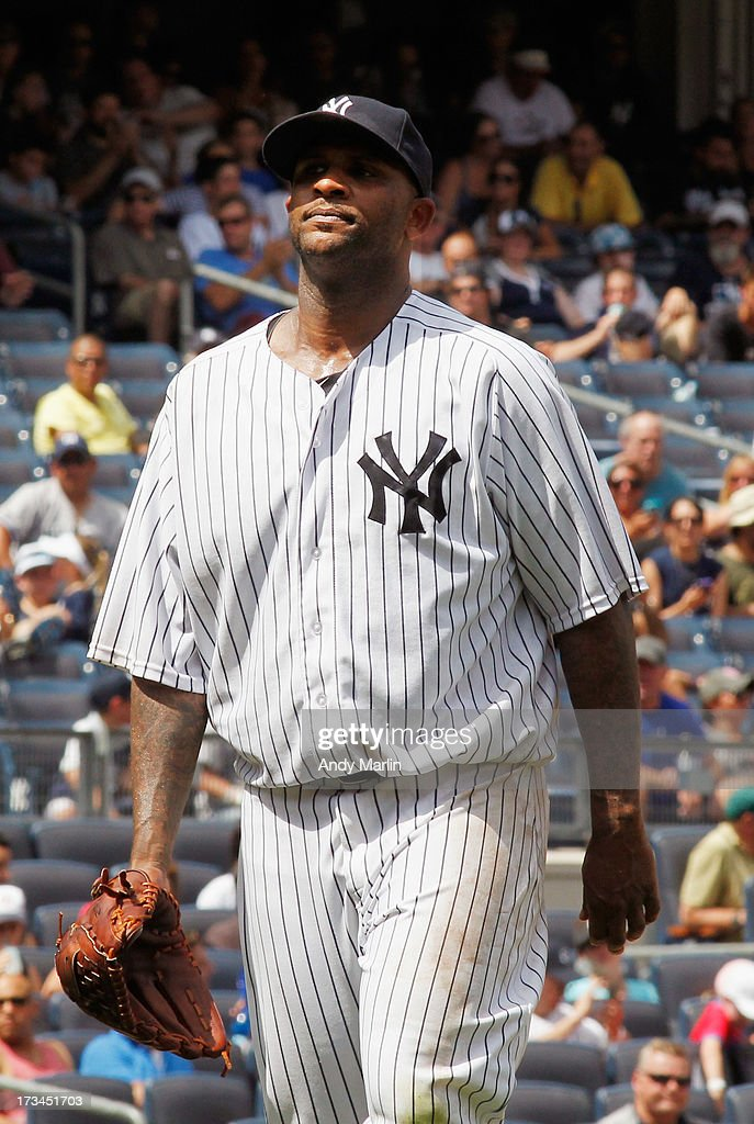 CC Sabathia # 52 of the New York Yankees leaves the mound after giving up eight runs and eight hits in 4 innings against the Minnesota Twins at Yankee Stadium on July 14, 2013 in the Bronx borough of New York City.