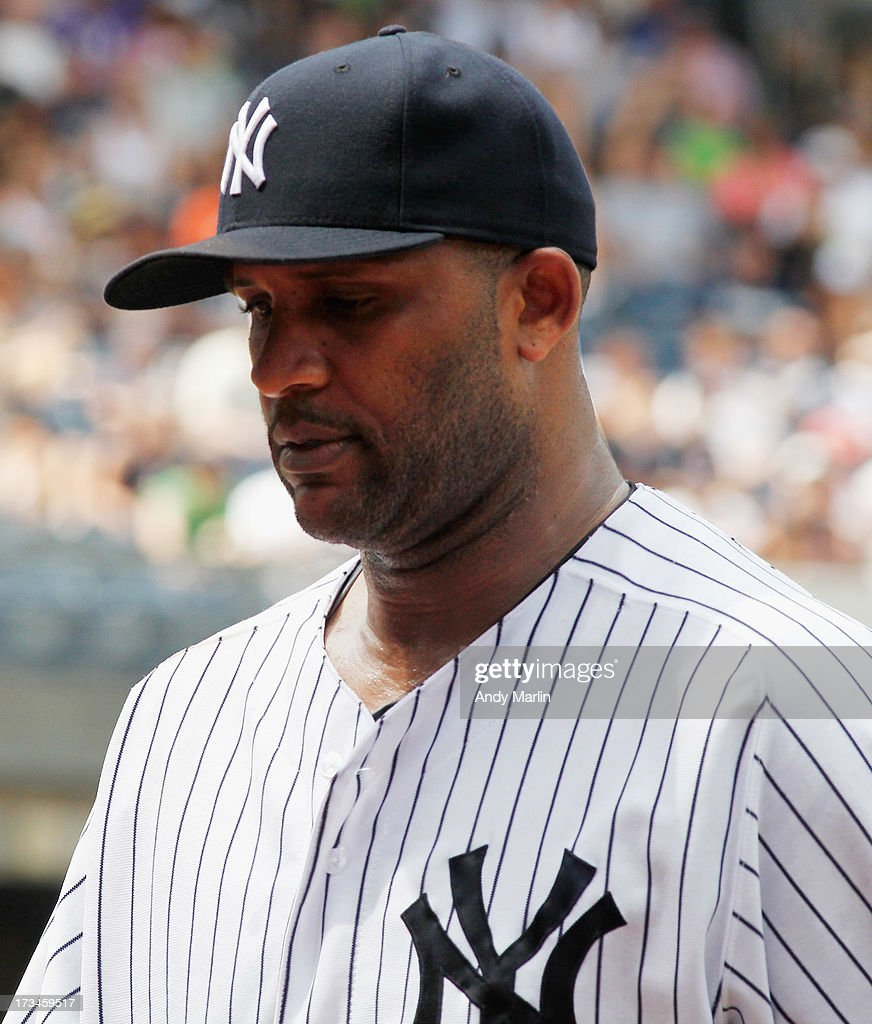 CC Sabathia # 52 of the New York Yankees leaves the mound after giving up eight runs and eight hits in four innings against the Minnesota Twins at Yankee Stadium on July 14, 2013 in the Bronx borough of New York City. The Twins defeated the Yankees 10-4.
