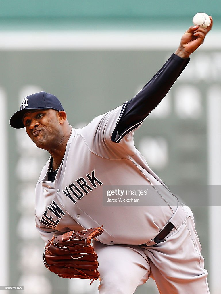 CC Sabathia #52 of the New York Yankees pitches against the Boston Red Sox in the first inning during the game on September 14, 2013 at Fenway Park in Boston, Massachusetts.